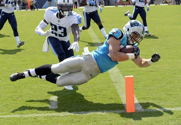 "<div class=""meta image-caption""><div class=""origin-logo origin-image ap""><span>AP</span></div><span class=""caption-text"">Panthers rookie running back Christian McCaffrey dives into the end zone for a touchdown on a 17-year run in the first half. (Mark Zaleski)</span></div>"