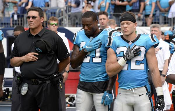"<div class=""meta image-caption""><div class=""origin-logo origin-image ap""><span>AP</span></div><span class=""caption-text"">Panthers coach Ron Rivera and players stand for the national anthem. (Mark Zaleski)</span></div>"