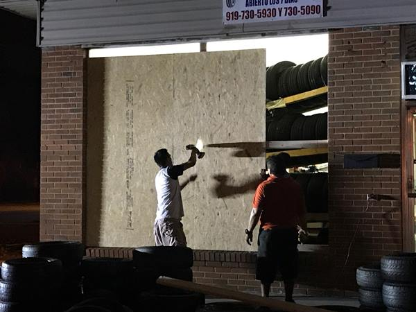 <div class='meta'><div class='origin-logo' data-origin='WTVD'></div><span class='caption-text' data-credit='Robert Judson'>They're boarding up the windows at Chavez tires on Brightleaf Boulevard.</span></div>