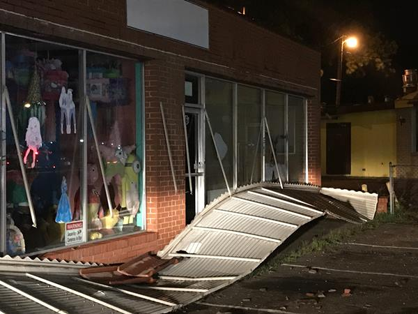 <div class='meta'><div class='origin-logo' data-origin='WTVD'></div><span class='caption-text' data-credit='Robert Judson'>The storm knocked off the awning and some roof tiles at Dulceria La Piñata.</span></div>