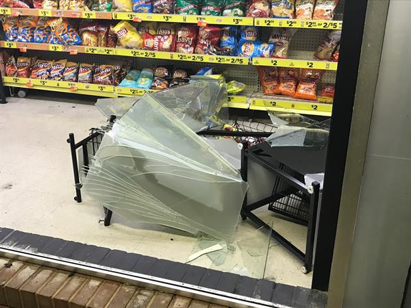 <div class='meta'><div class='origin-logo' data-origin='WTVD'></div><span class='caption-text' data-credit='Robert Judson'>This is the Dollar General on Brightleaf Boulevard, where one of the front windows was blown in.</span></div>