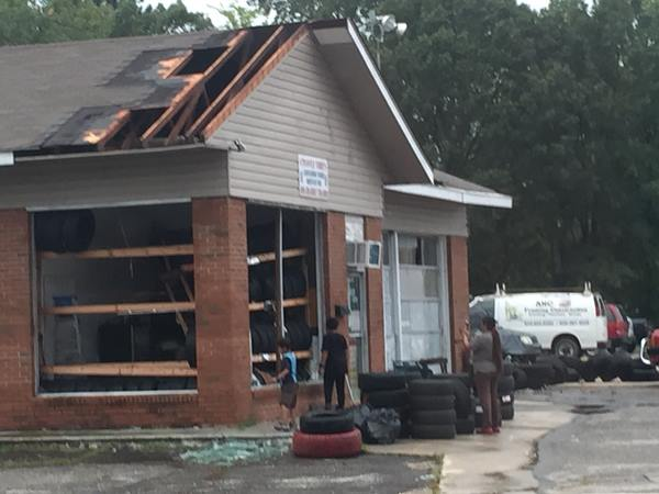<div class='meta'><div class='origin-logo' data-origin='WTVD'></div><span class='caption-text' data-credit='Randall Edge - ABC11 Eyewitness'>A tire shop with partial roof loss and glass blown out.</span></div>