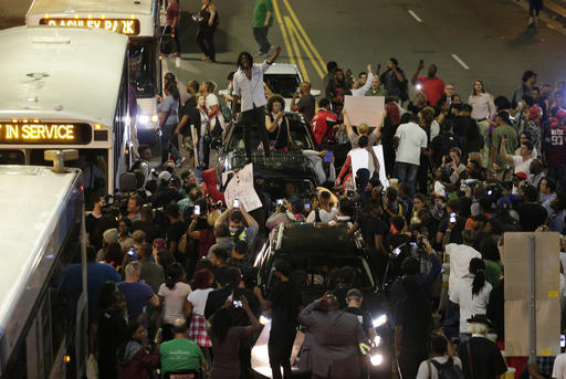 "<div class=""meta image-caption""><div class=""origin-logo origin-image none""><span>none</span></div><span class=""caption-text"">Demonstrators protest in Charlotte. (AP Photo/Chuck Burton)</span></div>"