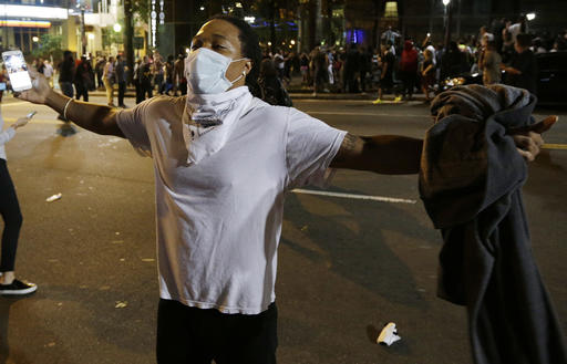 "<div class=""meta image-caption""><div class=""origin-logo origin-image none""><span>none</span></div><span class=""caption-text"">Demonstrators in Charlotte. (AP Photo/Chuck Burton)</span></div>"