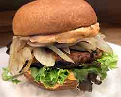 "<div class=""meta image-caption""><div class=""origin-logo origin-image none""><span>none</span></div><span class=""caption-text"">Mediterranean Lamb Burger - Traditional spice blend lamb burger on a potato bun with grilled onions and harissa yogurt sauce on a bed of mixed greens. Served by Neomonde Deli (Credit: NC State Fair)</span></div>"