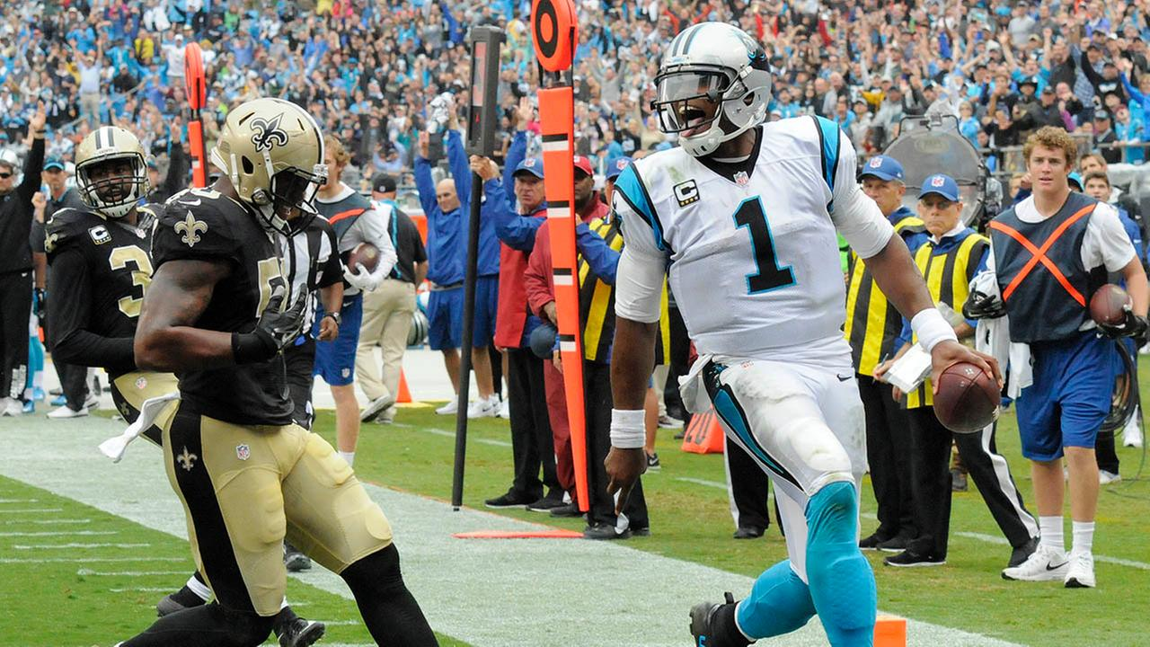 Carolina Panthers Cam Newton celebrates as he crosses the goal line for a touchdown past New Orleans Saints Stephone AnthonyMike McCarn