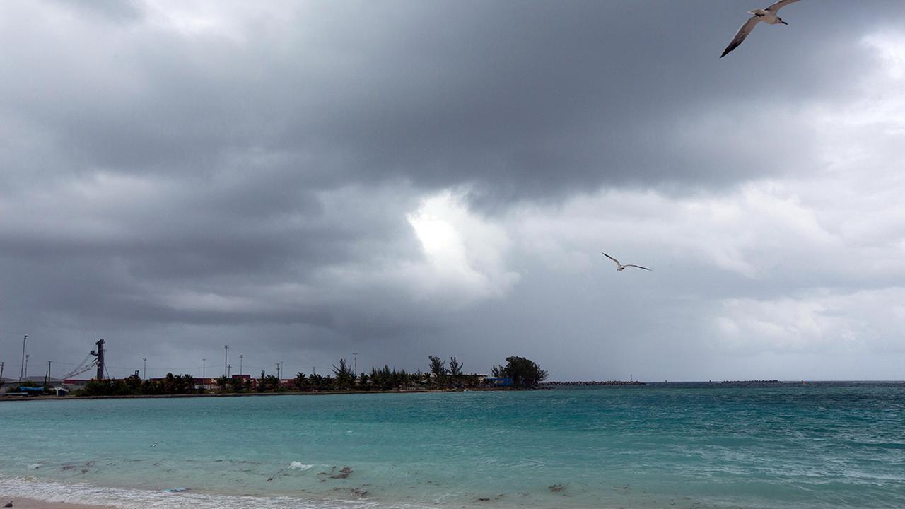 Skies begin to darken as Hurricane Joaquin passes through the region, seen from Nassau, Bahamas, early Friday, Oct. 2, 2015.