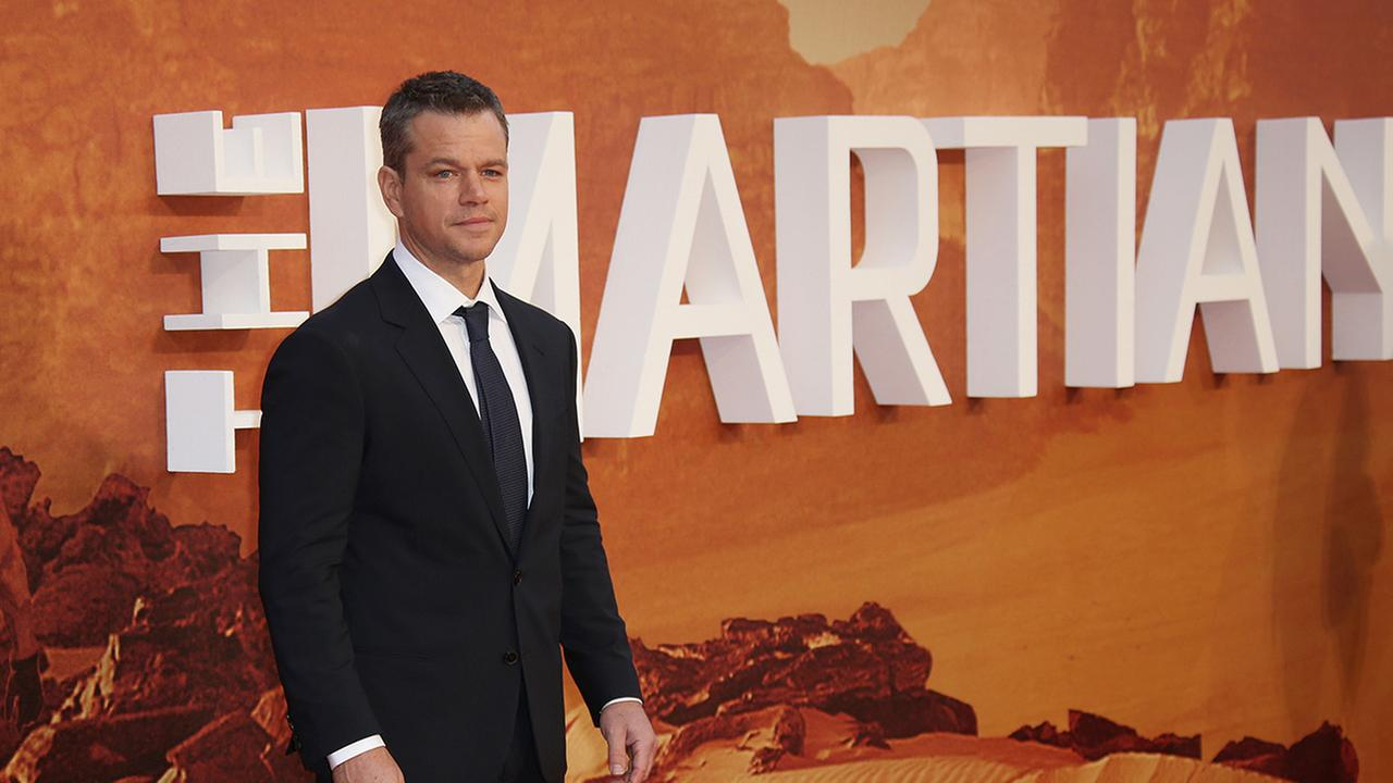 Actor Matt Damon poses for photographs as he arrives on the red carpet for the European Premiere of The Martian, at a central London cinema, Thursday, Sept. 24, 2015.
