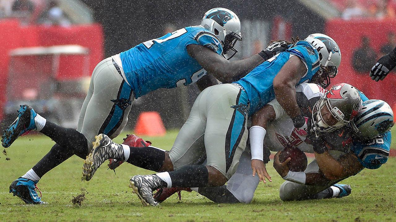 Tampa Bay Buccaneers quarterback Jameis Winston is sacked by Carolina Panthers Mario Addison, A.J. Klein, and Colin Cole, Sunday, Oct. 4, 2015, in Tampa, Fla.