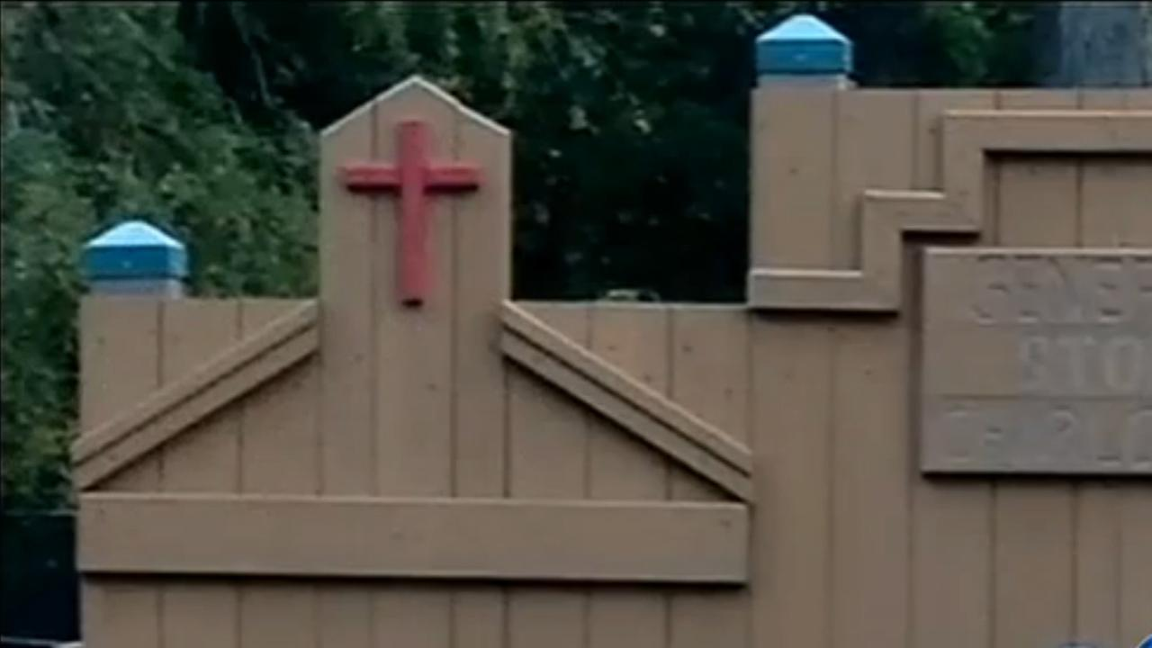 Cross removed from childrens playground in Charlotte after mother complains.