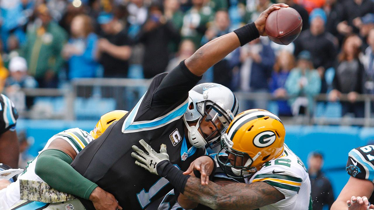 Carolina Panthers Cam Newton (1) reaches the ball over the goal line for a touchdown against the Green Bay PackersBob Leverone