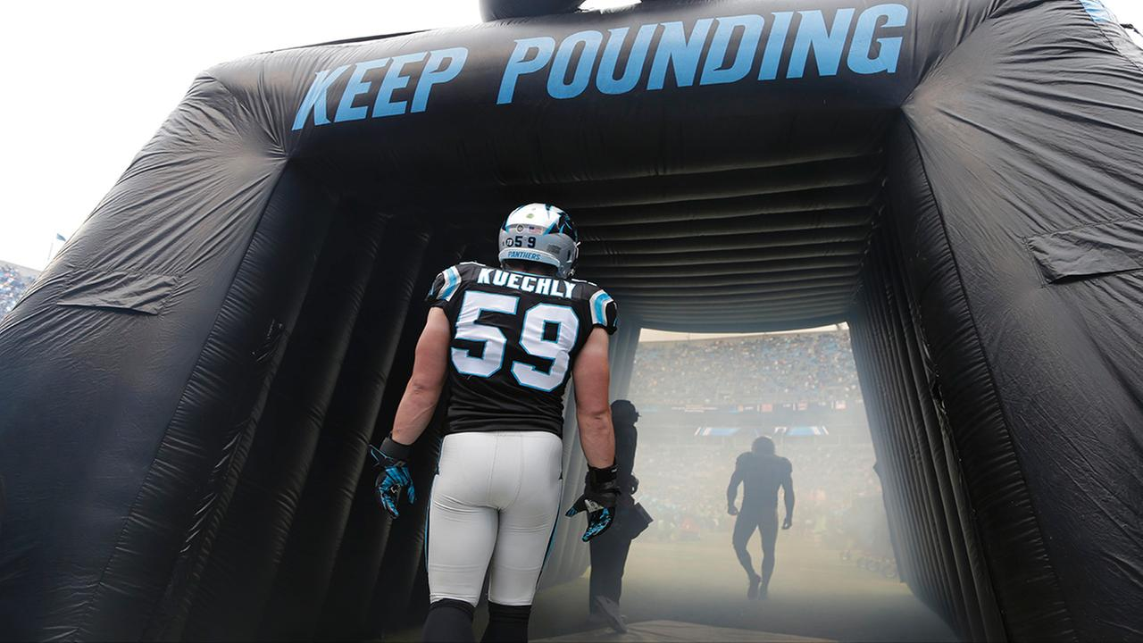 Carolina Panthers Luke Kuechly (59) waits to be introduced before an NFL football game against the Green Bay Packers in Charlotte, N.C., Sunday, Nov. 8, 2015.
