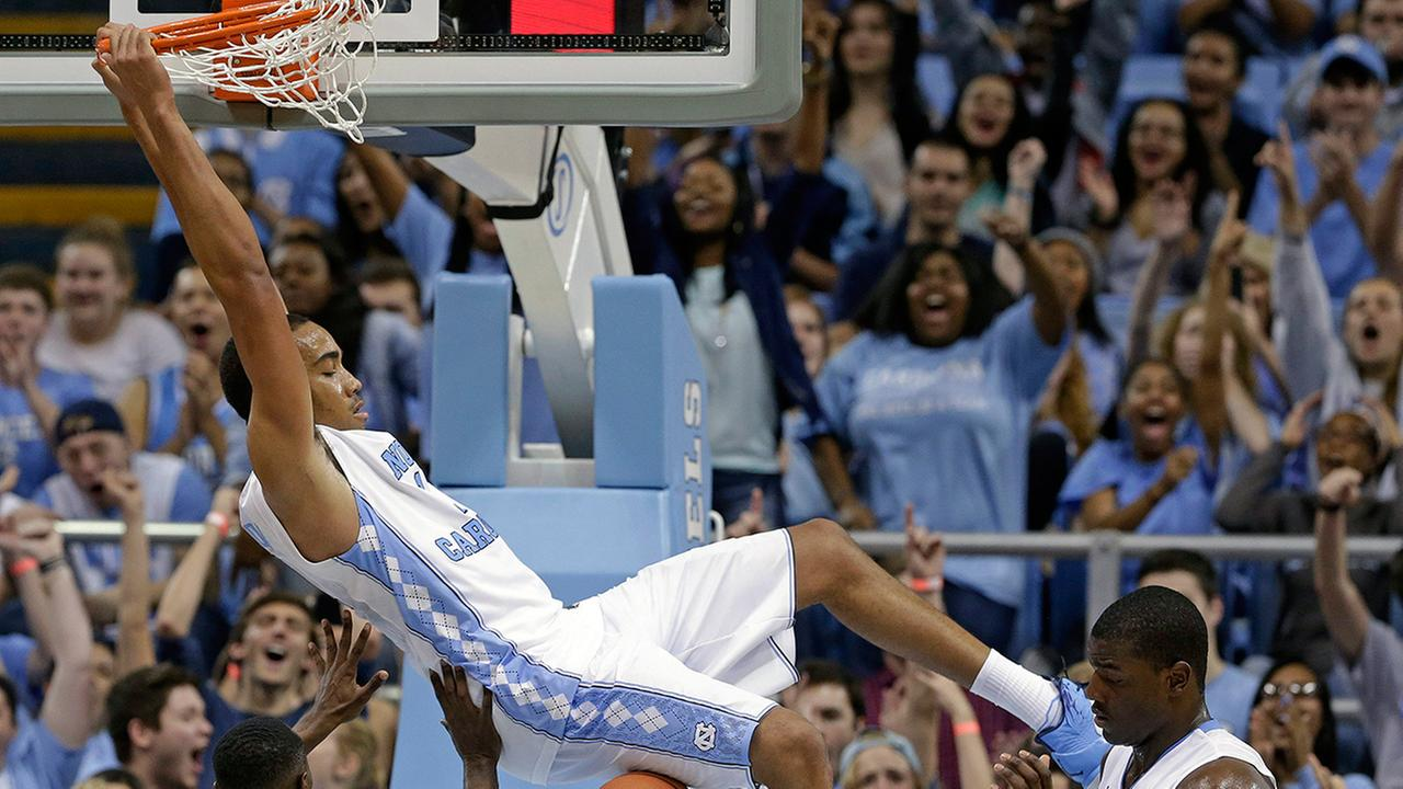 UNCs Brice Johnson dunks over Guilfords Justen Best (3) as UNCs Joel James looks on during the second half of an NCAA college exhibition basketball game Friday, Nov. 6, 2015.