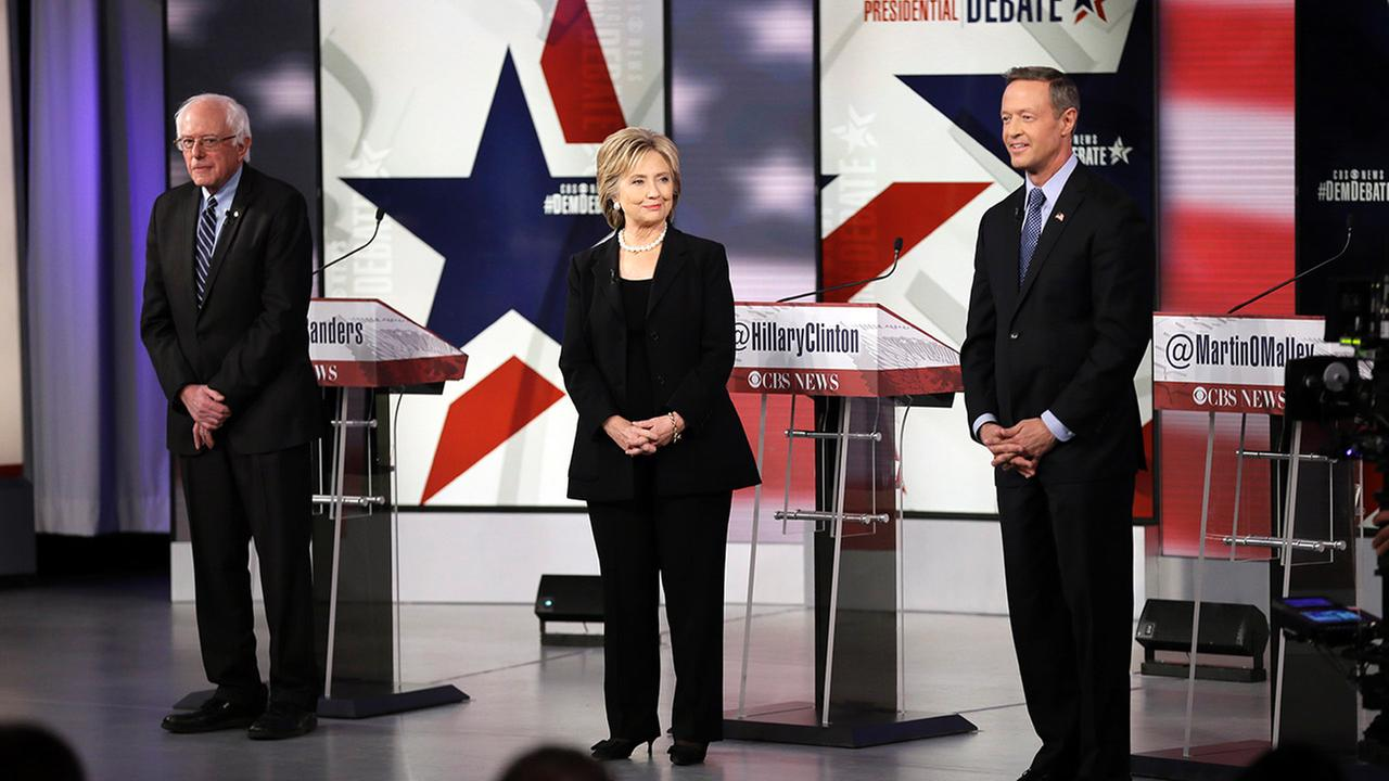 Democratic presidential candidates Bernie Sanders, left, Hillary Rodham Clinton and Martin OMalley take the stage before a Democratic presidential primary debate