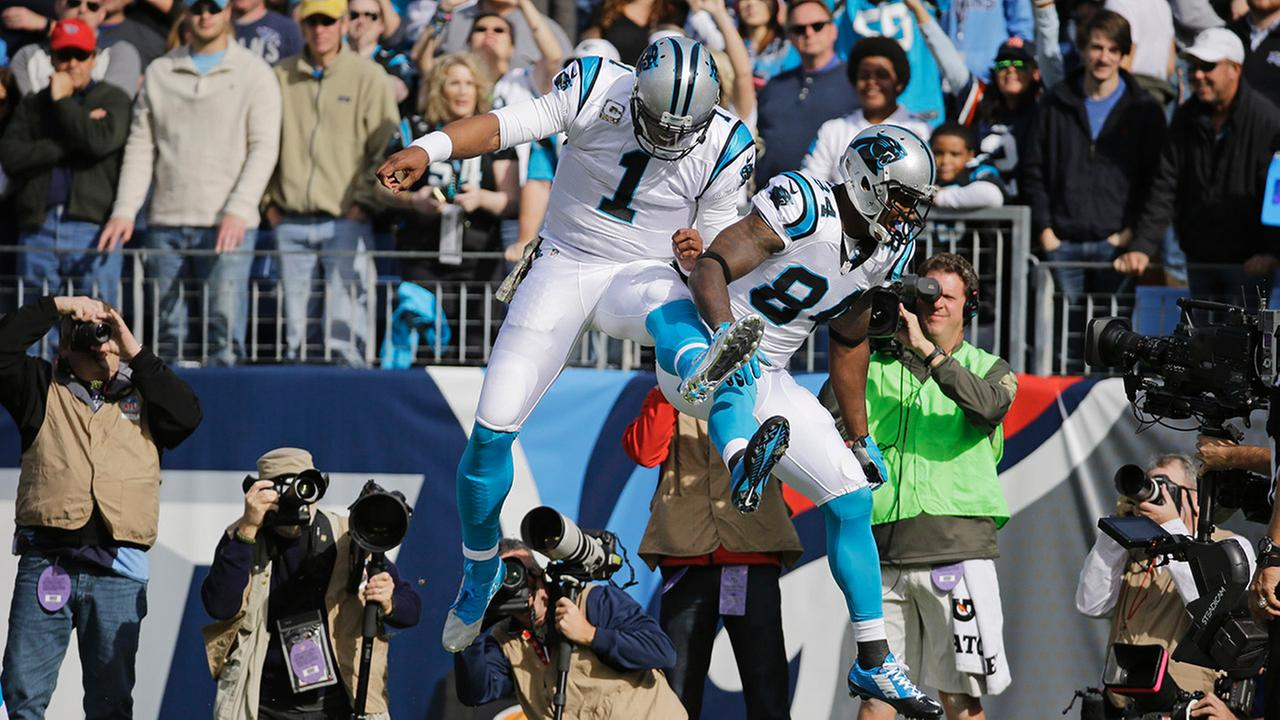 Carolina Panthers tight end Ed Dickson (84) celebrates with quarterback Cam Newton (1) after Dickson caught a 1-yard touchdown pass against the Tennessee TitansMark Zaleski