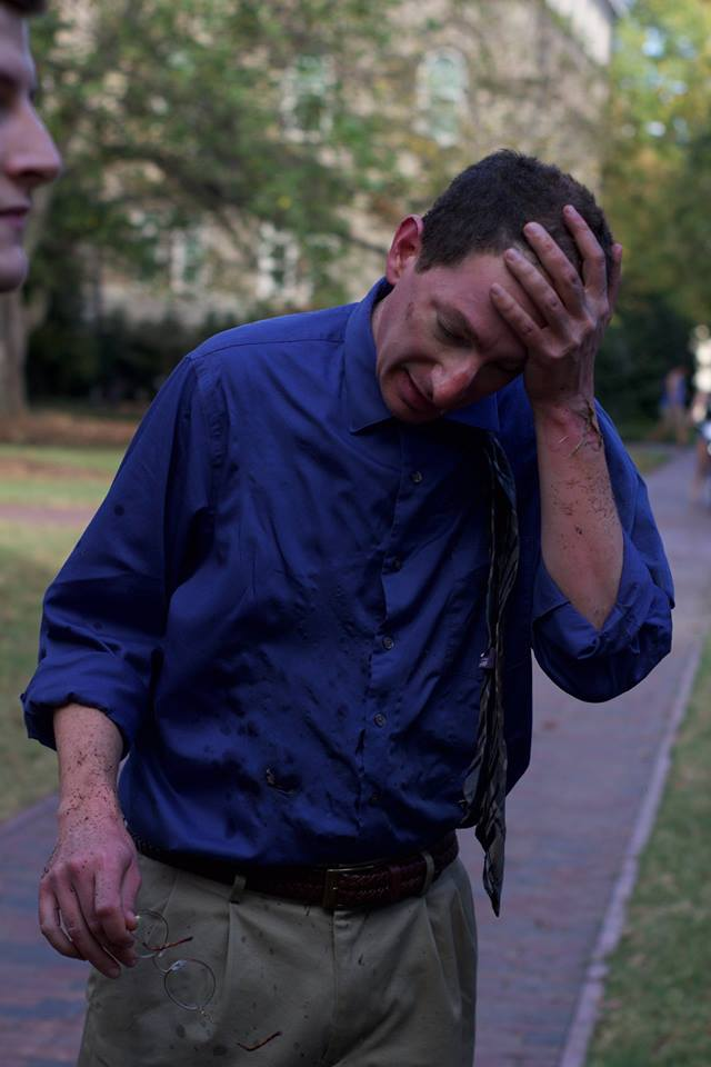 <div class='meta'><div class='origin-logo' data-origin='none'></div><span class='caption-text' data-credit='Evan White/@EJWimages'>Bystander moments after being burned by the explosion</span></div>