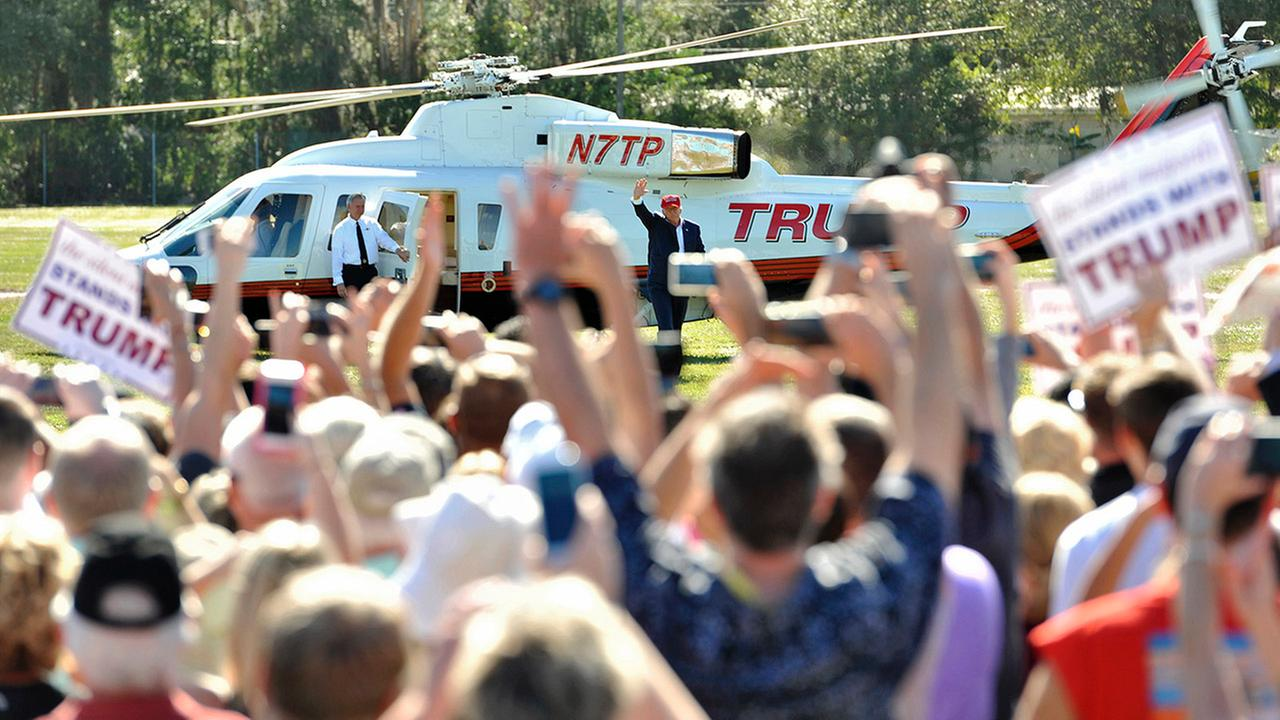 Republican presidential hopeful Donald Trump arrives by helicopter to speak with supporters at a campaign rally Saturday, Nov. 28, 2015 at Robarts Arena in Sarasota, Fla.
