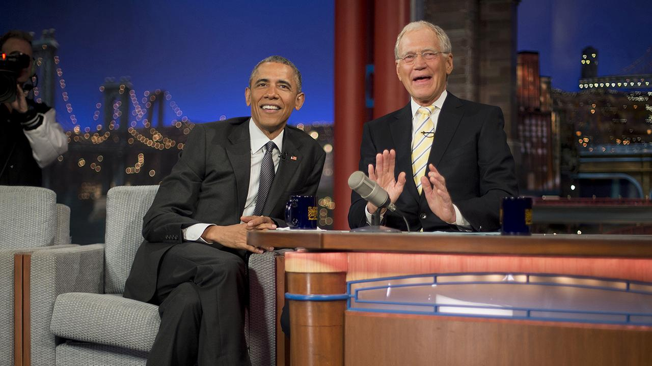 President Barack Obama with host David Letterman pause during a break at a taping of CBS The Late Show with David Letterman at the Ed Sullivan Theater in New York, May 4, 2015