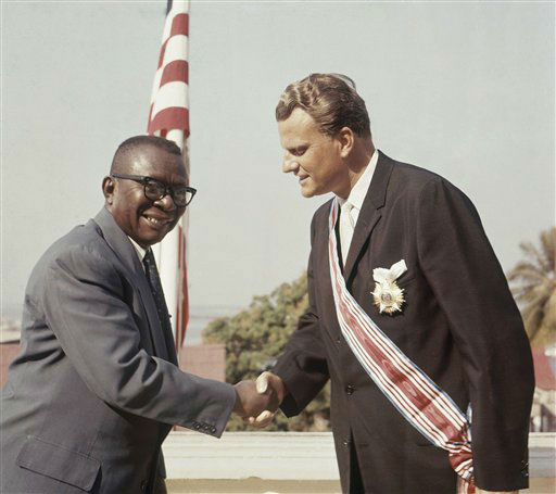 <div class='meta'><div class='origin-logo' data-origin='AP'></div><span class='caption-text' data-credit=''>Evangelist Billy Graham gets Grand Commander Human Order of African Redemption from President of Liberia, William V.S. Tubman in 1960.</span></div>