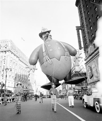"<div class=""meta image-caption""><div class=""origin-logo origin-image ap""><span>AP</span></div><span class=""caption-text"">A huge balloon in the form of comic fireman floats over Broadway during the annual Macy's Thanksgiving Day Parade in New York, Nov. 25, 1948.</span></div>"