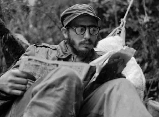 <div class='meta'><div class='origin-logo' data-origin='none'></div><span class='caption-text' data-credit=''>Cuban guerrilla leader Fidel Castro does some reading while at his rebel base in Cuba's Sierra Maestra mountains in this 1957 photo. (AP Photo/Andrew St. George)</span></div>