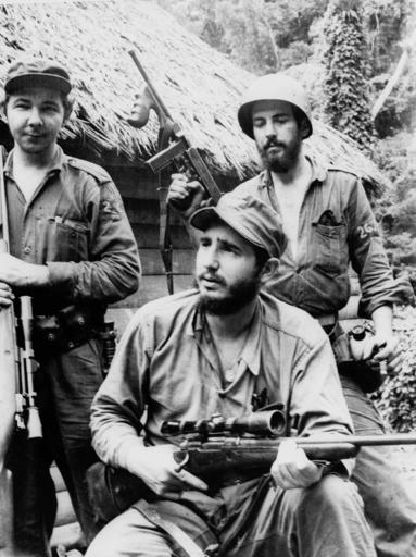<div class='meta'><div class='origin-logo' data-origin='none'></div><span class='caption-text' data-credit=''>In this March 14, 1957 file photo, Fidel Castro, the young anti-Batista guerrilla leader, center, is seen with his brother Raul Castro,  (AP Photo/Andrew St. George)</span></div>
