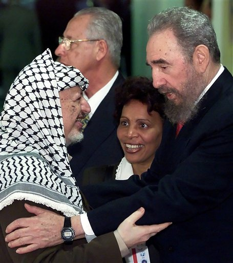 <div class='meta'><div class='origin-logo' data-origin='none'></div><span class='caption-text' data-credit=''>Castro greets Yasser Arafat. (AP photo)</span></div>