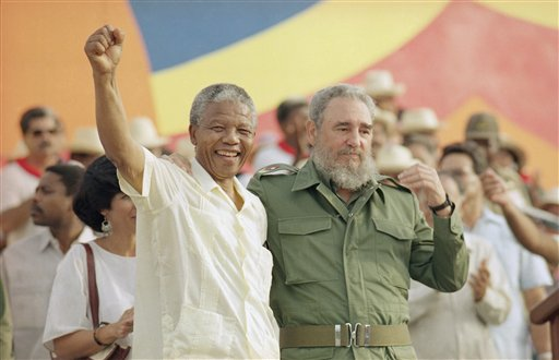 <div class='meta'><div class='origin-logo' data-origin='none'></div><span class='caption-text' data-credit=''>Cuban President Fidel Castro, right, and African leader Nelson Mandela in Matanzas Saturday, July 27, 1991. (AP Photo)</span></div>