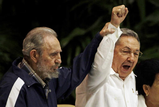 <div class='meta'><div class='origin-logo' data-origin='none'></div><span class='caption-text' data-credit=''>Fidel Castro, left, raises his brother's hand, Cuba's President Raul Castro, center, on Aug. 13, 2016.  (AP Photo/Javier Galeano, File)</span></div>