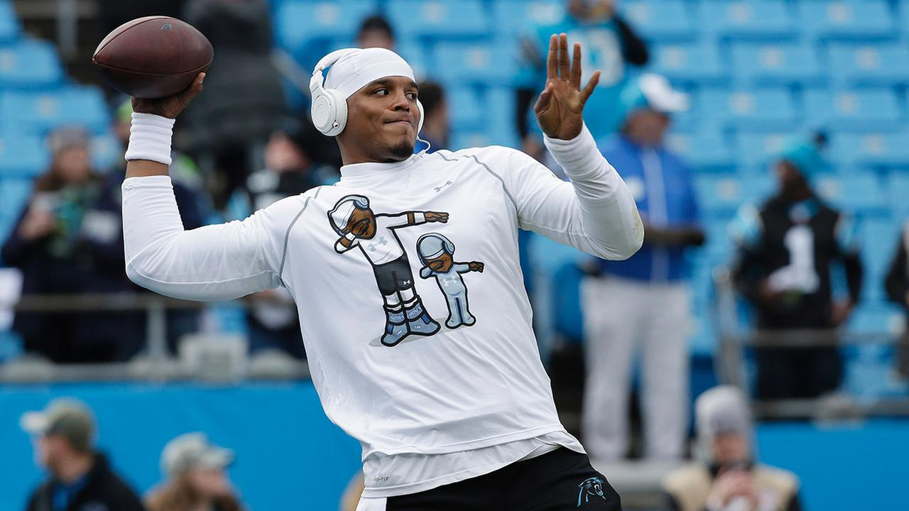 Carolina Panthers quarterback Cam Newton warms up before the first half of an NFL divisional playoff football game between the Carolina Panthers and the Seattle Seahawks