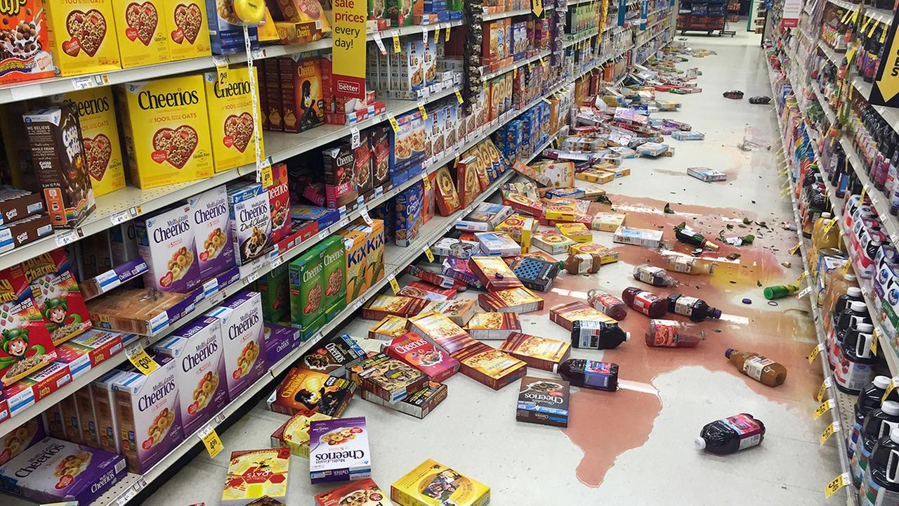 In this photo provided by Vincent Nusunginya, boxes of cereal and bottles of juice lie on the floor of a Safeway grocery store following a magnitude 6.8 earthquake in Alaska
