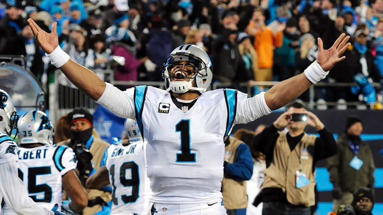 Carolina Panthers Cam Newton celebrates his touchdown run during the second half the NFL football NFC Championship game against the Arizona Cardinals, Sunday