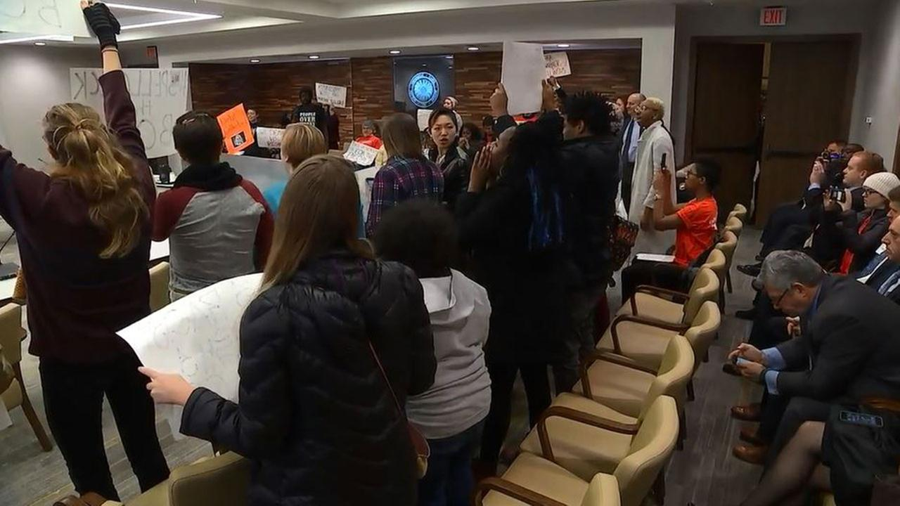 Students protest at UNC Board of Governors meeting Tuesday