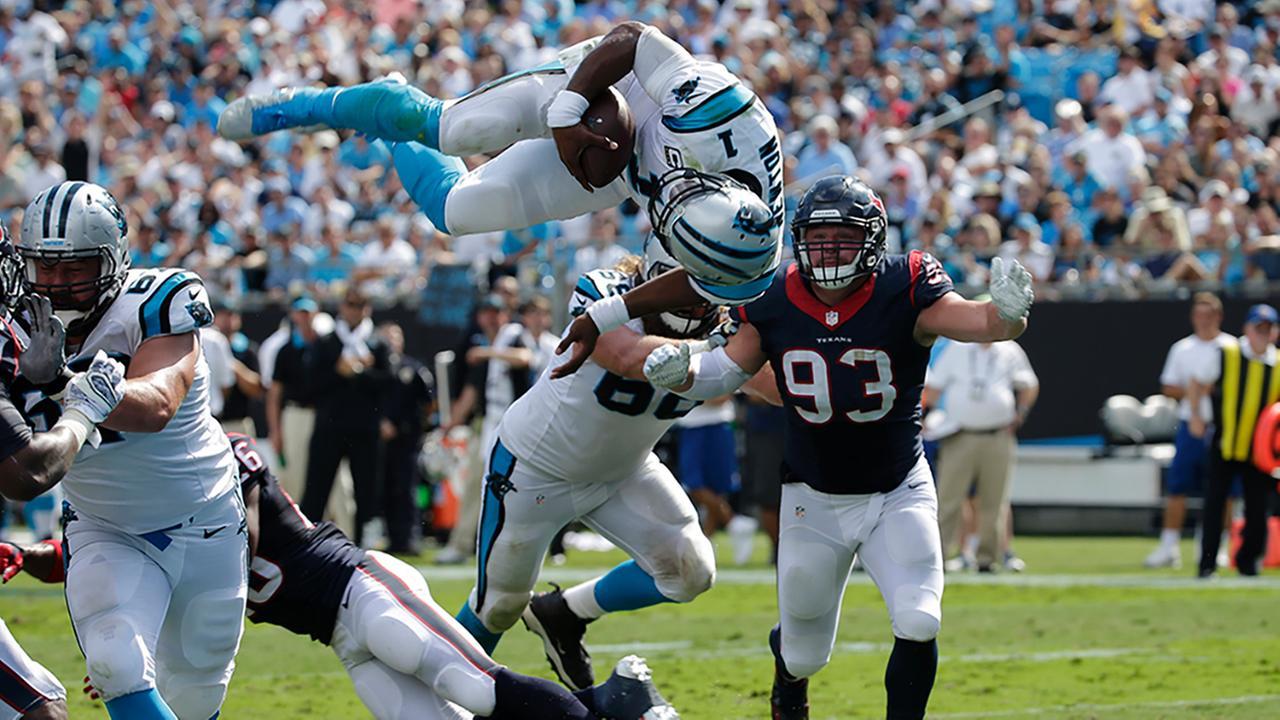 Cam Newton flips for a touchdown against the Texans on Sept. 20, 2015.Chuck Burton