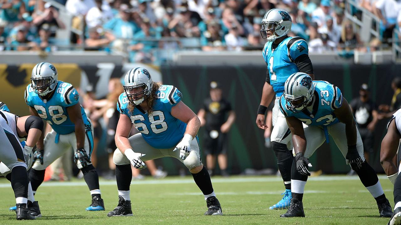Carolina Panthers tackle Michael Oher set up to block as quarterback Cam Newton prepares to take the snap during game against the Jacksonville Jaguars in Florida Sept. 13, 2015