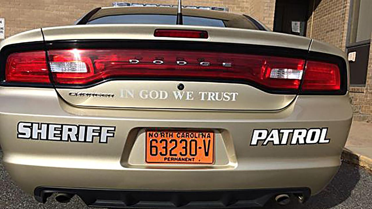 Patrol cars in one western North Carolina county will soon display decals saying In God We Trust.