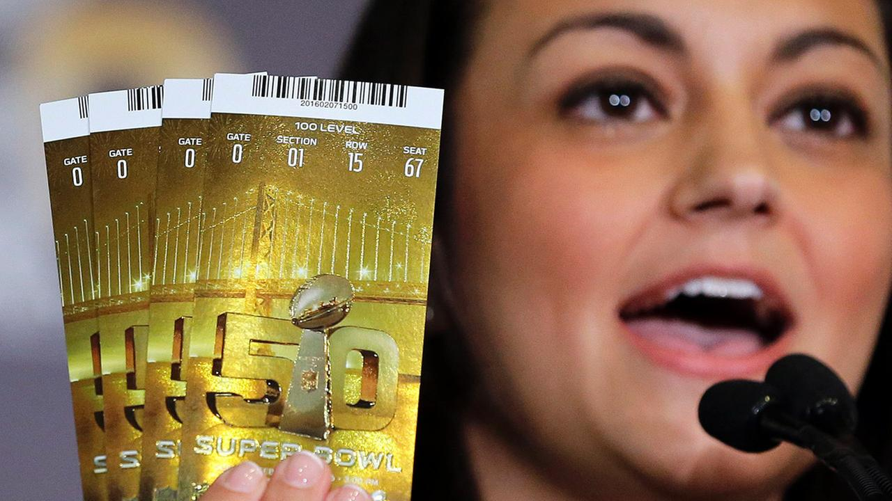 Dolores F. Dibella, NFL Counsel, holds up authentic Super Bowl 50 tickets during a counterfeit merchandise news conference Thursday, Feb. 4, 2016, in San Francisco.
