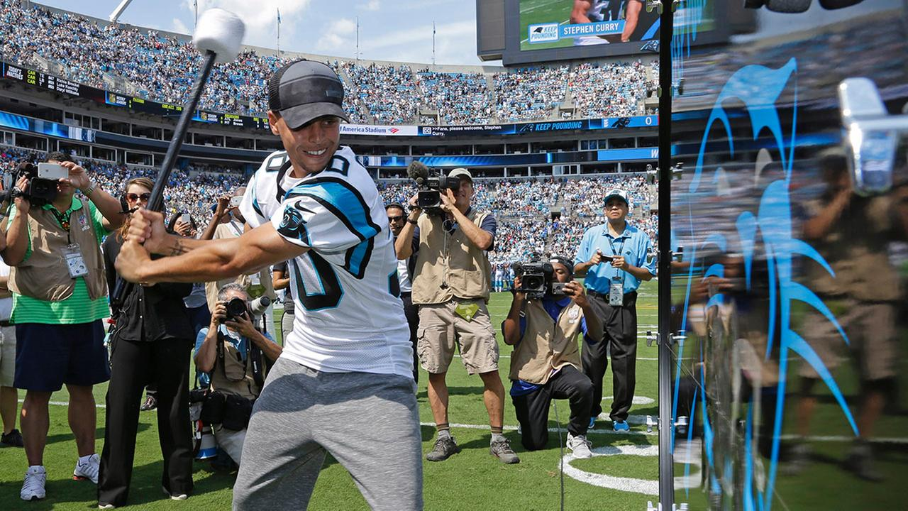 Stephen Curry prepares to Pound the Drum before an NFL football game between the Carolina Panthers and the Houston Texans in Charlotte, N.C., Sunday, Sept. 20, 2015.