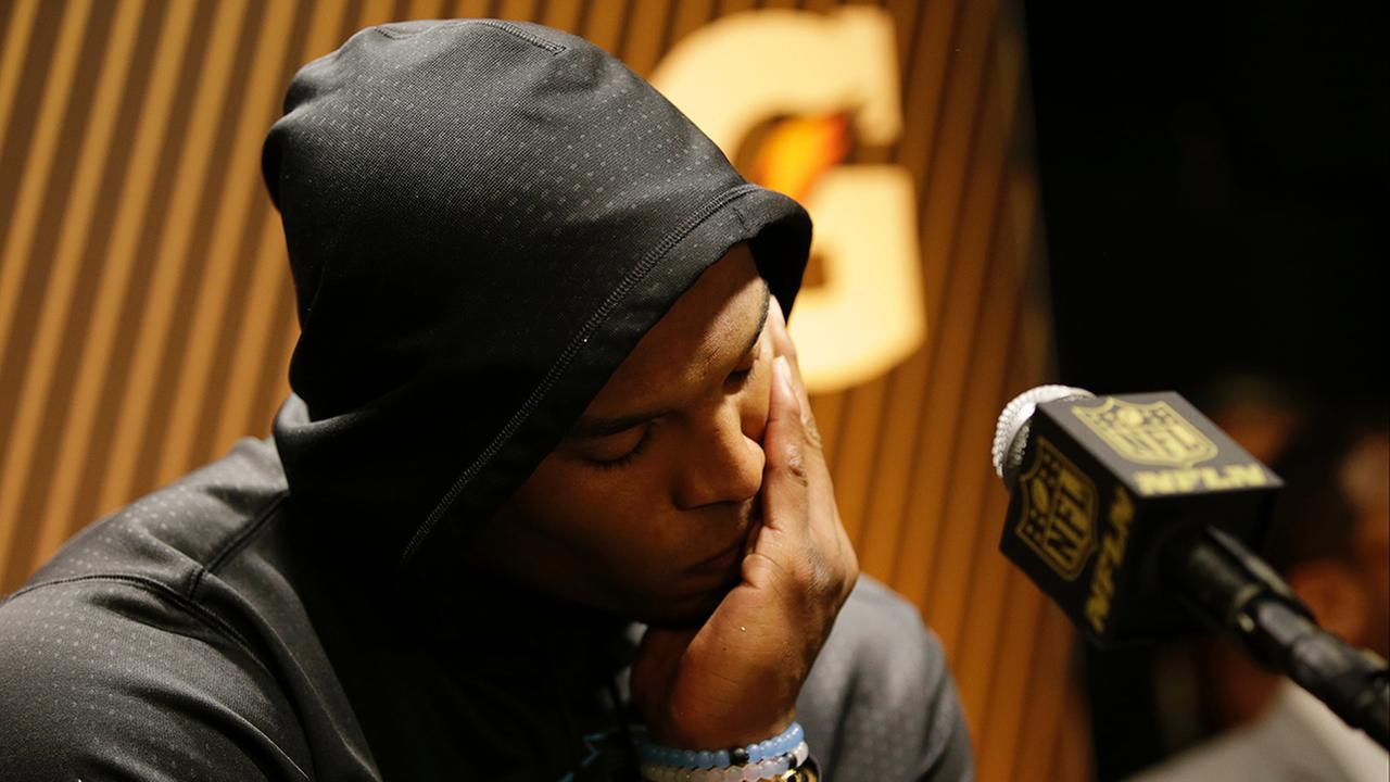 Carolina Panthers Cam Newton answers questions after the NFL Super Bowl 50 football game against the Denver Broncos Sunday, Feb. 7, 2016, in Santa Clara, Calif.