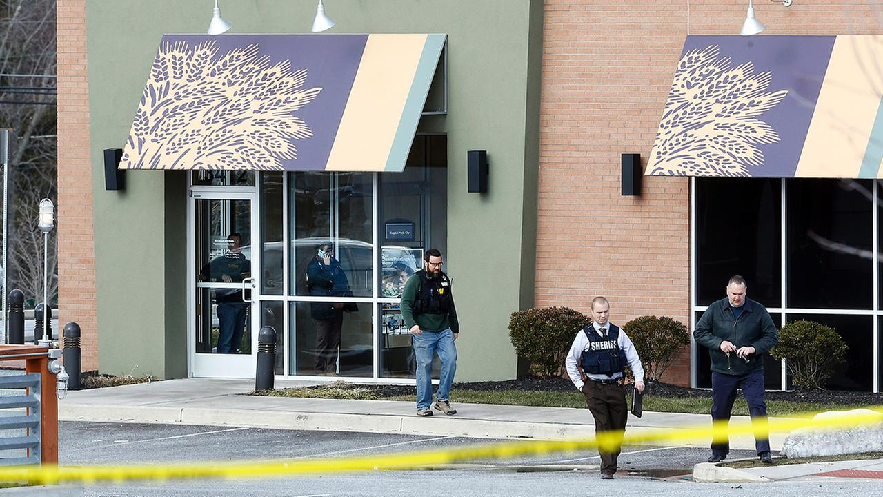 Investigators work  the scene of a shooting at a shopping center in Abingdon, Md., on Wednesday.