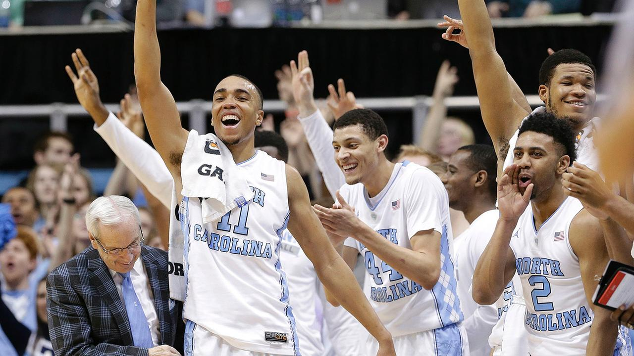North Carolina coach Roy Williams reacts with Brice Johnson, Justin Jackson, Joel Berry II and Kennedy Meeks near the end of an NCAA college basketball game against Pittsburgh