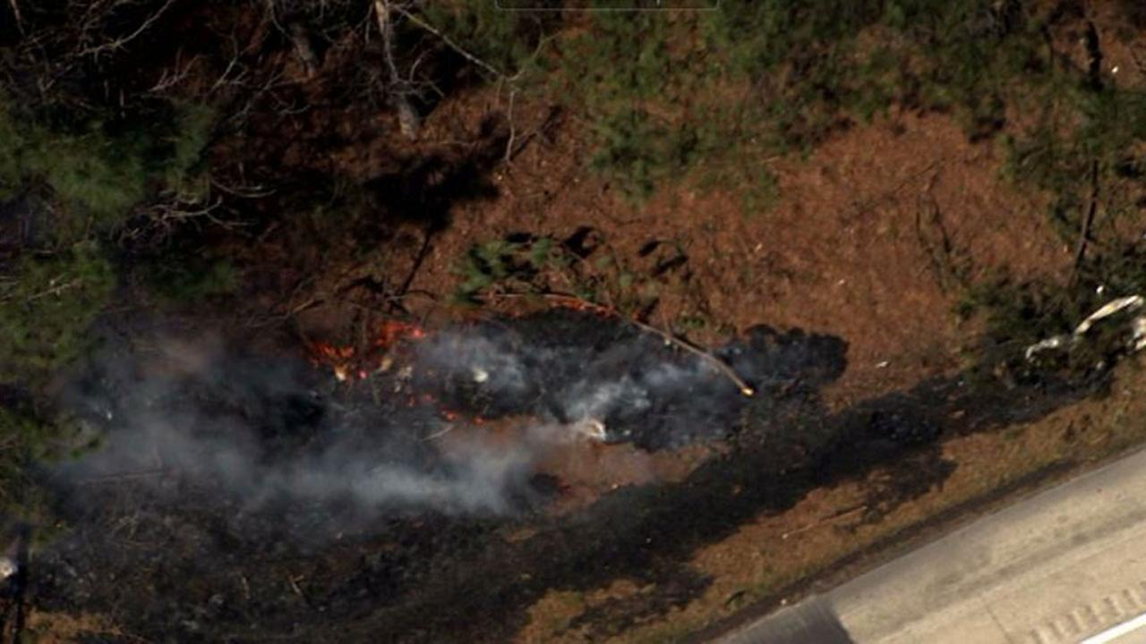 Image from Chopper11 HD shows several fires burning along eastbound I-40 at the Wake/Johnston County line Thursday morning.