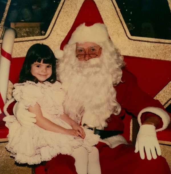 "<div class=""meta image-caption""><div class=""origin-logo origin-image ""><span></span></div><span class=""caption-text"">An adorable Heather Waliga visiting Santa. (WTVD Photo)</span></div>"