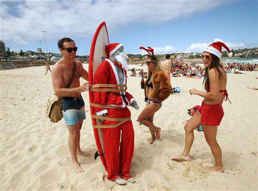 "<div class=""meta image-caption""><div class=""origin-logo origin-image none""><span>none</span></div><span class=""caption-text"">A figure in Santa costume is strapped to a surfboard for easy transport along Bondi Beach in Sydney, Australia.  (AP Photo/ Rick Rycroft)</span></div>"