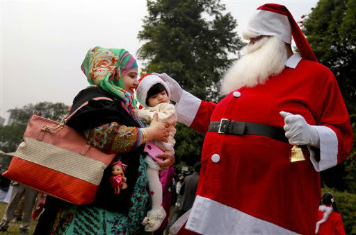 "<div class=""meta image-caption""><div class=""origin-logo origin-image none""><span>none</span></div><span class=""caption-text"">A man dressed as Santa Claus blesses a child at a Christmas party in Dhaka, Bangladesh.  (AP Photo/ A.M. Ahad)</span></div>"