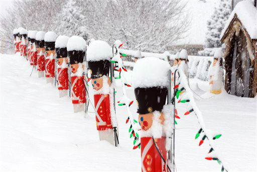 """<div class=""""meta image-caption""""><div class=""""origin-logo origin-image none""""><span>none</span></div><span class=""""caption-text"""">Christmas decorations are seen during a snow storm in Omaha, Neb.  (AP Photo/ Nati Harnik)</span></div>"""