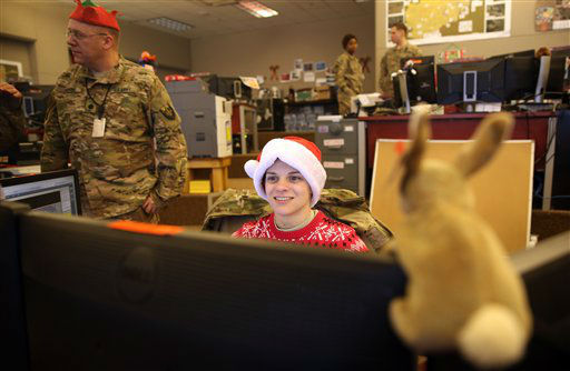 """<div class=""""meta image-caption""""><div class=""""origin-logo origin-image none""""><span>none</span></div><span class=""""caption-text"""">U.S. soldiers work in their office on Christmas day at Bagram Air Field, north of Kabul, Afghanistan.  (AP Photo/ Massoud Hossaini)</span></div>"""