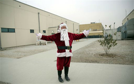 """<div class=""""meta image-caption""""><div class=""""origin-logo origin-image none""""><span>none</span></div><span class=""""caption-text"""">A U.S. soldier dressed up as Santa Claus during Christmas day celebrations at Bagram Air Field, north of Kabul, Afghanistan.  (AP Photo/ Massoud Hossaini)</span></div>"""