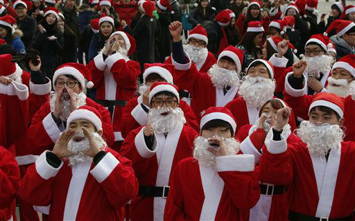 """<div class=""""meta image-caption""""><div class=""""origin-logo origin-image none""""><span>none</span></div><span class=""""caption-text"""">Hundreds of volunteers clad in Santa Claus costumes cheer during a Christmas charity event as they gather to deliver gifts for the poor in downtown Seoul, South Korea.  (AP Photo/ Lee Jin-man)</span></div>"""