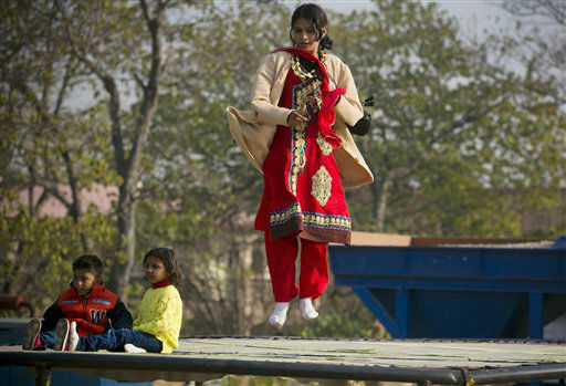 "<div class=""meta image-caption""><div class=""origin-logo origin-image none""><span>none</span></div><span class=""caption-text"">Pakistani Christian girl Maryam Chaudary jumps on a trampoline in a Christian neighborhood for the Christmas holiday in Islamabad, Pakistan.   (AP Photo/ B.K. Bangash)</span></div>"